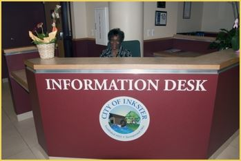 Lady sitting behind the front desk