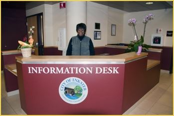 Lady standing behind front desk
